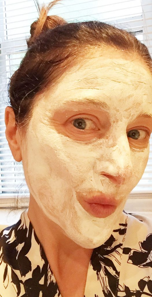 claire with a face mask on