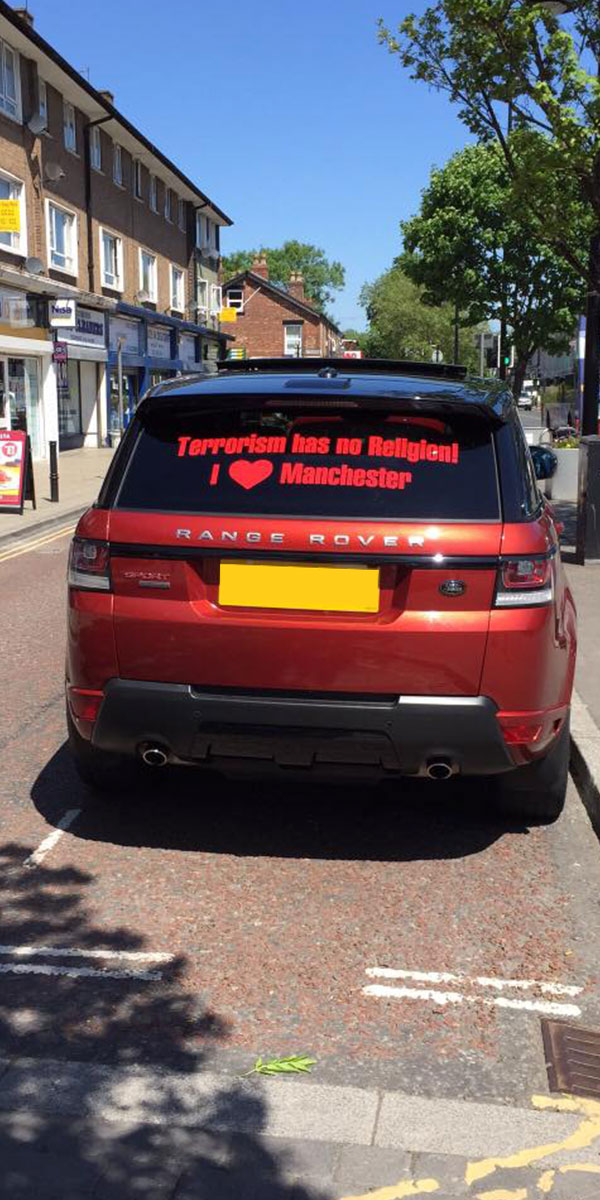 A Car wrap showing solidarity to Manchester