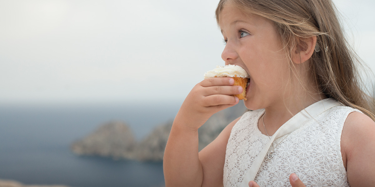 Yasmin eating a cupcake