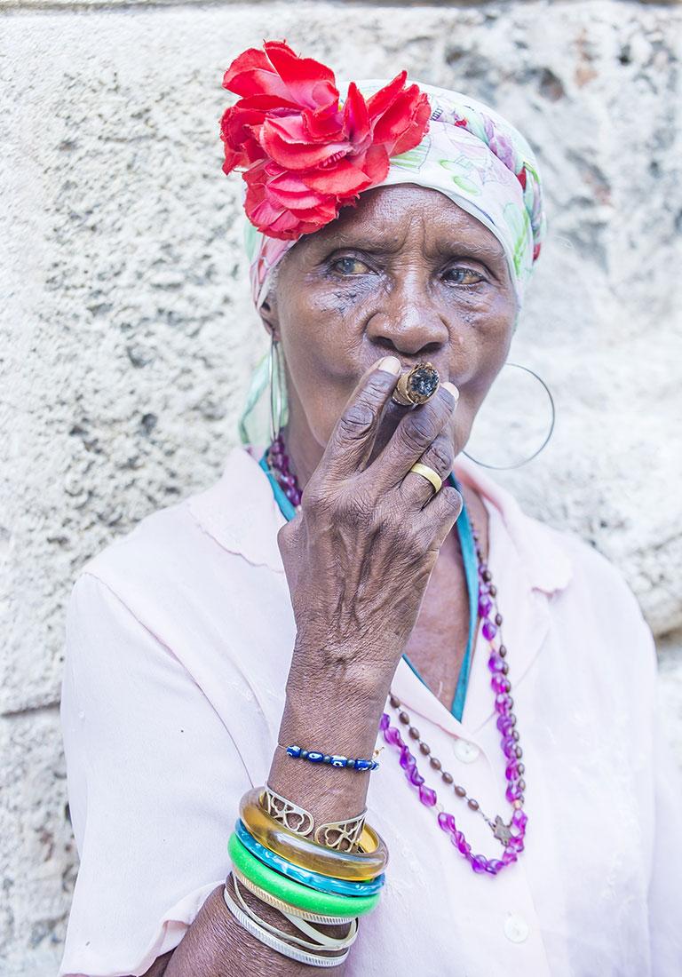 an old cuban woman smoking a cigar