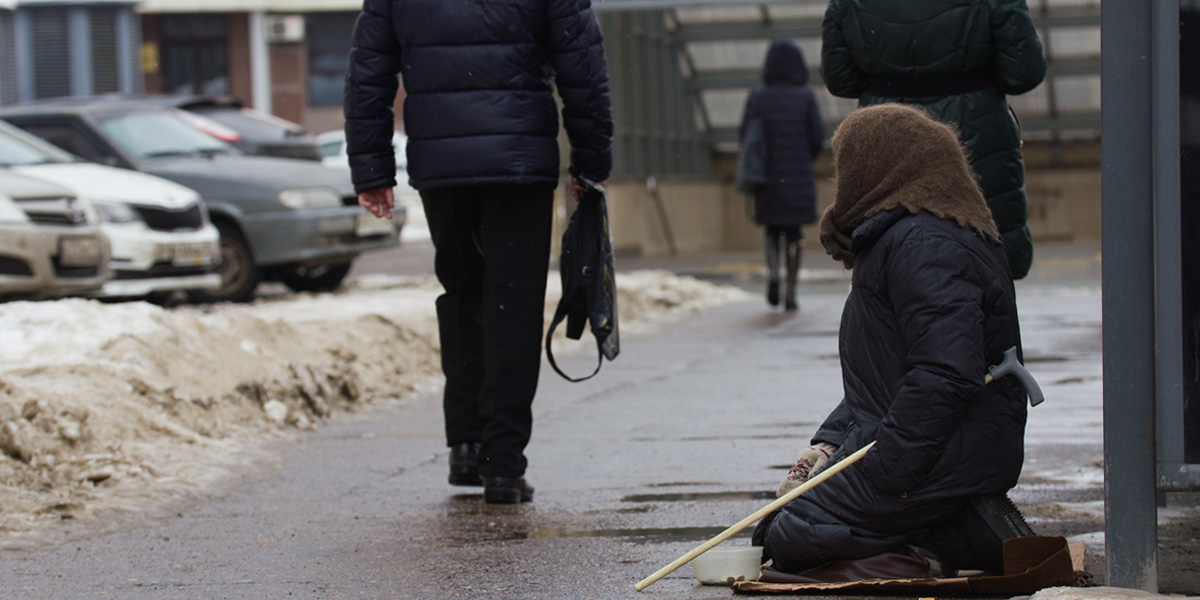 A homeless person on a cold street