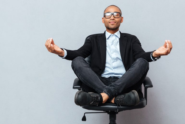 Man sat on a chair meditating
