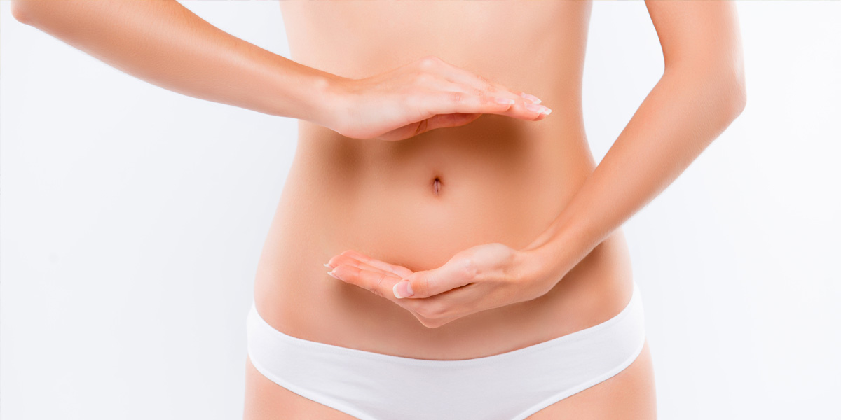 woman holding her hands near her belly for gut health